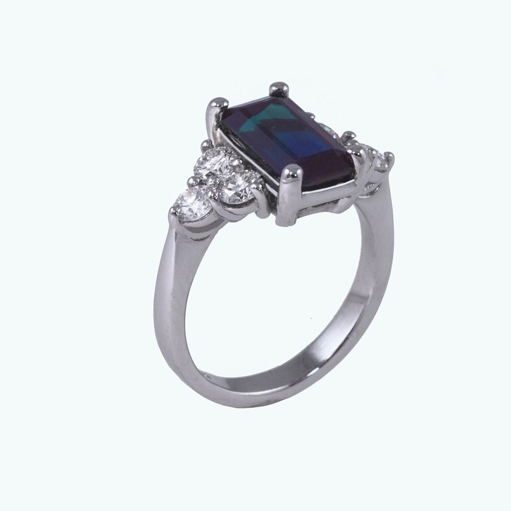 Tourmaline ring with diamond trefoil shoulders